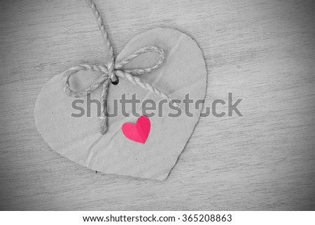 Series of Valentines Card, Heart Shape Blank Cardboard with Flax Cord hanging over wood background. Photoshop Vintage Effect. Selective Color. - stock photo