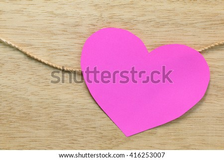 Series of Valentines Card. Pink heart paper cut on wooden background. Image of Valentines day. - stock photo
