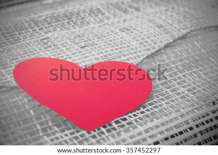 Series of Valentines Card. Red heart paper cut with on wooden weaving background, in very shallow focus. Image of Valentines day. Selective Color. - stock photo