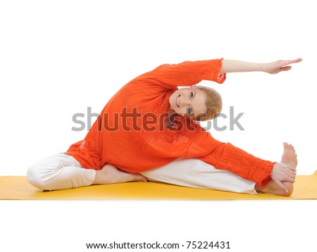 series or yoga photos. young woman streching on yellow pilates mat - stock photo
