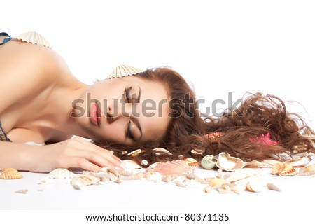 series photo of  the pretty young woman with long red curly hair lying on the floor beach, sea shell with marine cockleshell, isolated over white background. Concept freshness, Spa resort - stock photo