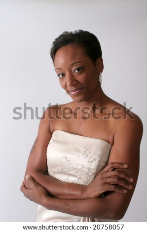 Serious african american woman with her arms crossed - stock photo