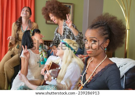 Serious African woman with friends laughing and singing - stock photo