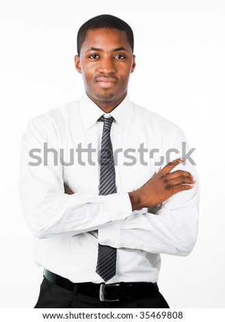 Serious Afro-American businessman with folded arms looking at the camera - stock photo