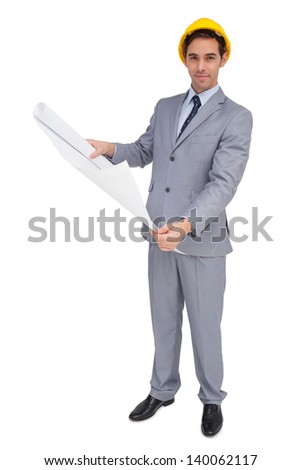 Serious architect with hard hat holding plans on white background - stock photo