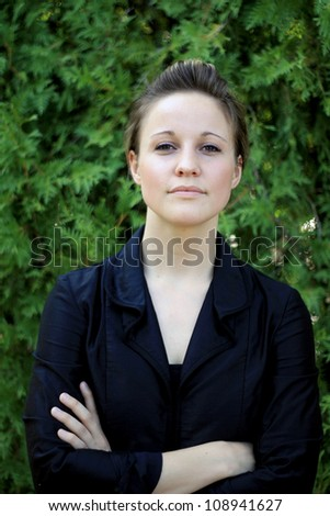 Serious Attractive Young Woman Looking At Camera - stock photo