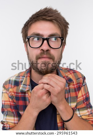 Serious bearded man in glasses on white background. Man in stylish shirt weighing his beard down with excitement. - stock photo