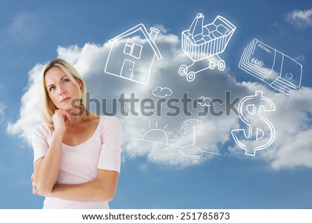 Serious blonde thinking with hand on chin against cloudy sky - stock photo
