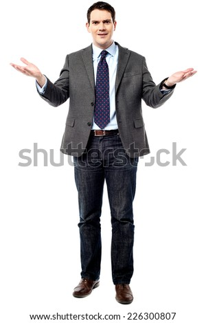 Serious business man showing welcome sign isolated on white  - stock photo