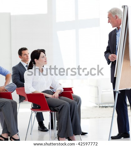 Serious business people at a conference in the office - stock photo