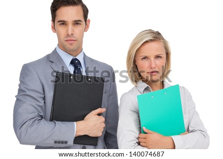 Serious business people standing together with folders on white background - stock photo