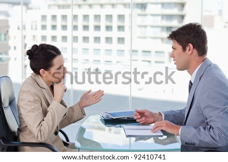 Serious business team during a brainstorming in a meeting room - stock photo