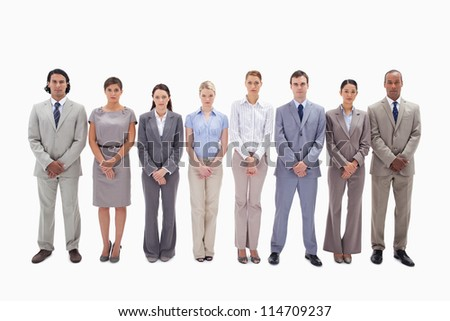 Serious business team side by side holding their hands against white background - stock photo