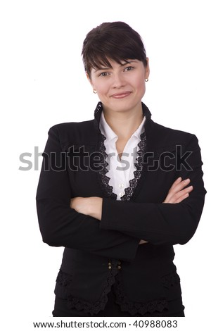Serious business woman with brown hair is standing. Brunette businesswoman dressed in black suit. - stock photo