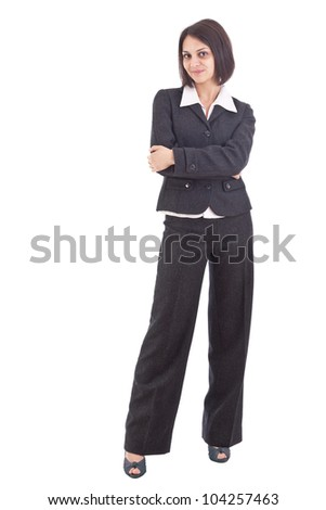 Serious business woman with crossed arms against white background - stock photo