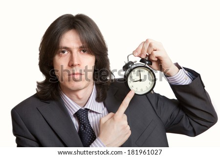 serious businessman pointing his finger at the start of the working day - stock photo