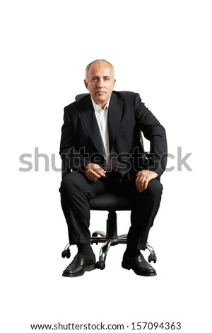 serious businessman sitting on office chair and looking at camera. isolated on white background - stock photo