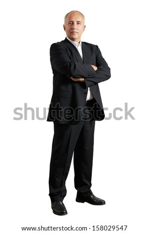 serious businessman standing in the studio and looking at camera - stock photo