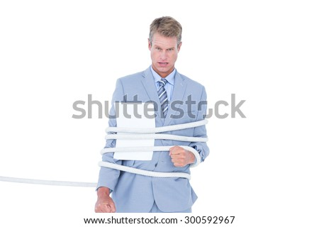 Serious businessman tied up at work on white background - stock photo