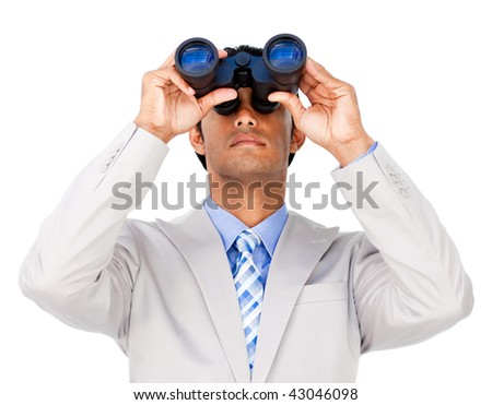 Serious businessman using binoculars isolated on a white background - stock photo
