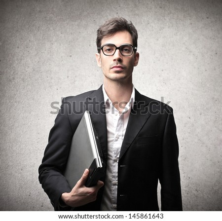 serious businessman with glasses and laptop  - stock photo