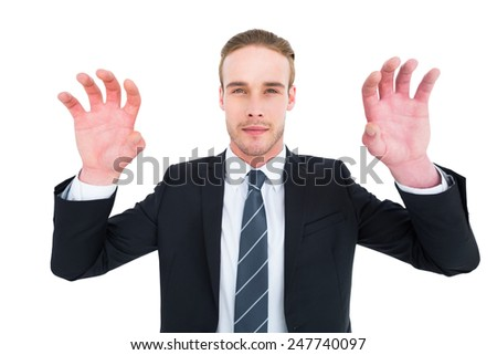 Serious businessman with hands up on white background - stock photo