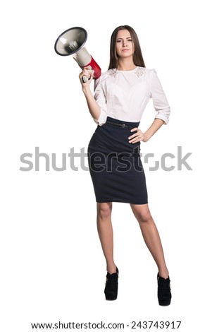 Serious businesswoman holding megaphone while posing on white background - stock photo