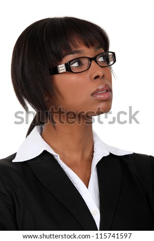 Serious businesswoman in glasses - stock photo