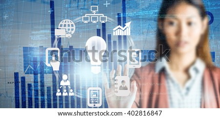 Serious businesswoman showing her hands against blue data - stock photo