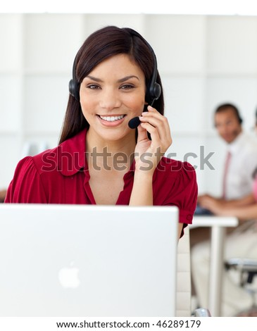 Serious Businesswoman talking on headset at work - stock photo