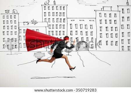 serious businesswoman wearing like superhero very fast running in drawn street - stock photo