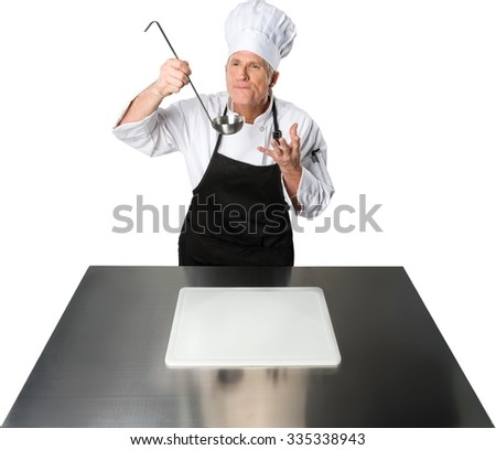 Serious Caucasian Chef  in uniform holding chef holding a ladle - Isolated - stock photo