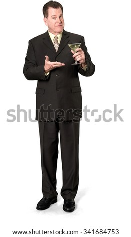 Serious Caucasian elderly man with short medium brown hair in business formal outfit holding martini glass - Isolated - stock photo
