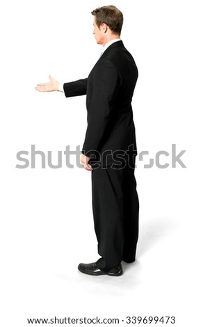 Serious Caucasian man with short black hair in business formal outfit offering handshake - Isolated - stock photo