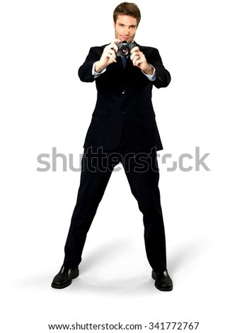 Serious Caucasian man with short medium blond hair in business formal outfit using camera - Isolated - stock photo