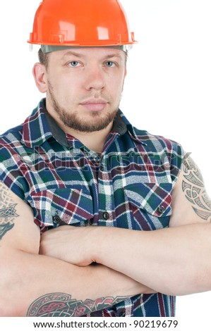 Serious caucasian tattooed building contractor in work shirt and hardhat, over a white background - stock photo