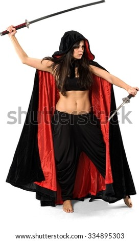 Serious Caucasian young woman with long dark brown hair in costume holding sword - Isolated - stock photo
