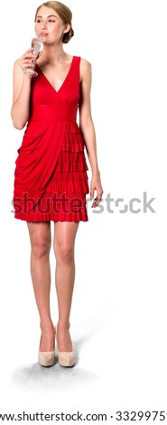 Serious Caucasian young woman with medium blond hair in evening outfit drinking champagne - Isolated - stock photo