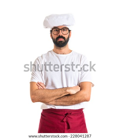 Serious chef with his arms crossed - stock photo