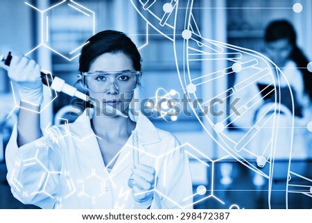 Serious chemist working with white dna helix diagram inteface against science graphic - stock photo