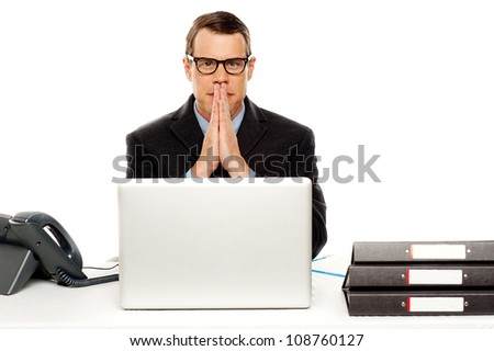 Serious corporate man looking at you isolated over white - stock photo