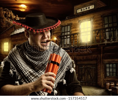 Serious cowboy mexican firing dynamite by cigar for bank robbery at night - stock photo