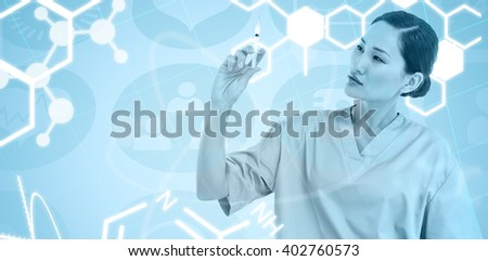 Serious doctor holding an injection in hospital against medical icons - stock photo