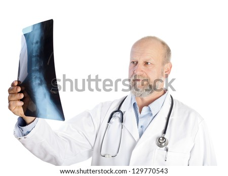 Serious doctor is holding an vertebrae X-ray file - stock photo