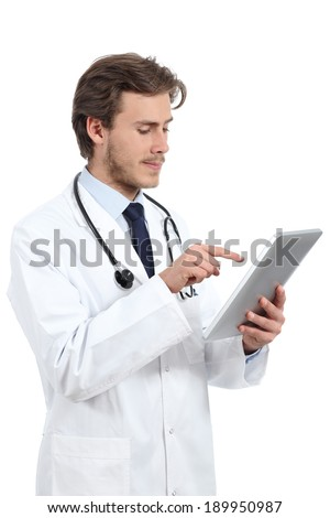 Serious doctor man browsing a tablet reader isolated on a white background                - stock photo