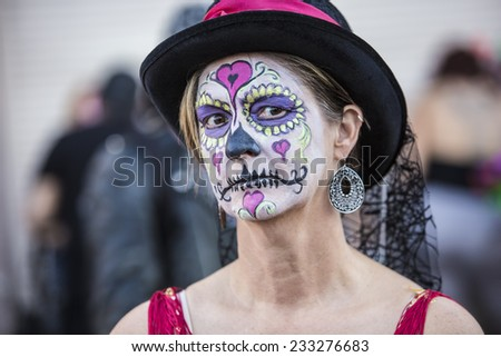 Serious female in hat with makeup for Dia De Los Muertos - stock photo