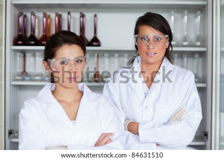Serious female science students posing in a laboratory - stock photo