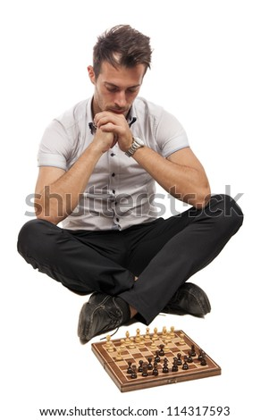 Serious focused man thinks on game of chess isolated on white - stock photo