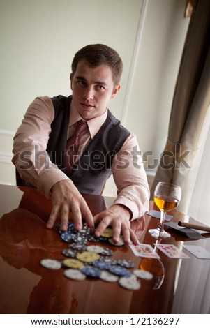 Serious gentleman is going to make a stake in poker - stock photo