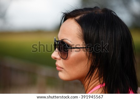 Serious girl`s in sunglasses outdoor portrait. - stock photo